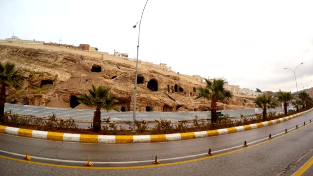 Empty Very Old Cave City in Centre of ShanlyUrfa Cars Drive in Front of Camera video
