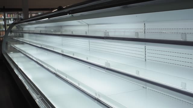 empty white shelves in a store, supermarket