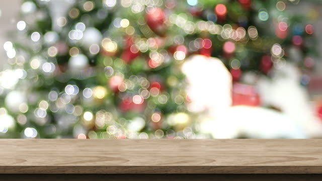 Empty wood table and snow falling with blur christmas tree bokeh light background,Backdrop template for display of product or design,food stand mock up