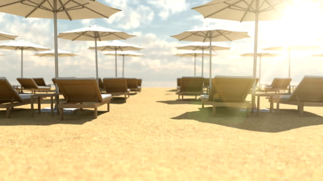 Empty wooden deck chairs and umbrellas on beach video