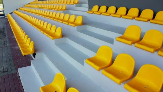 Empty yellow seats in a stadium