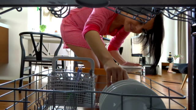 emptying the diswasher woman emptying the diswasher at home dishwasher stock videos & royalty-free footage