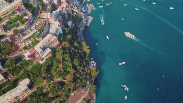 enchanting aerial shot of positano, amalfi coast - mar mediterraneo video stock e b–roll