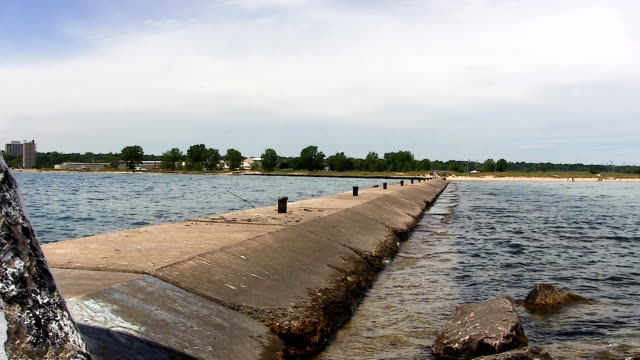 End Of Breakwater Waukegan Illinois Looking Back To Shore Waukegan Illinois Breakwater With Lake Michigan Small Waves On Both Sides Looking Back To Shore jetty stock videos & royalty-free footage