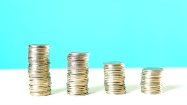 End of Financial Year and savings concept stacking coins stop motion animation.