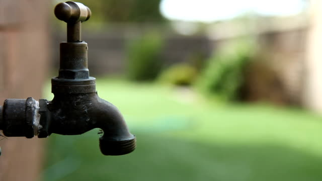 Endless Dripping Tap Faucet in Garden HD LOOP video