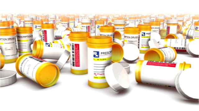endless empty pill bottles front view - amfetamin pills bildbanksvideor och videomaterial från bakom kulisserna