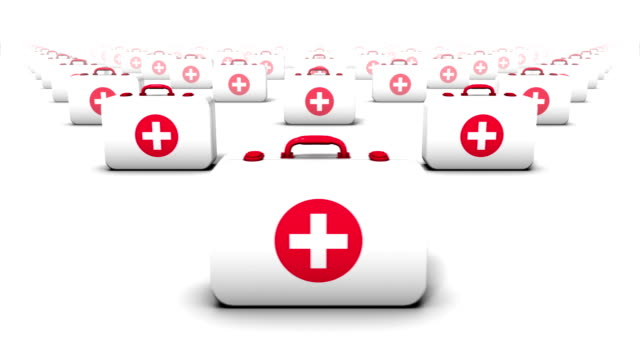 Endless First Aid Kits front view loop Seamless loop with camera passing across the fronts of endless rows of First Aid Kits extending in a grid pattern to the horizon medevac stock videos & royalty-free footage