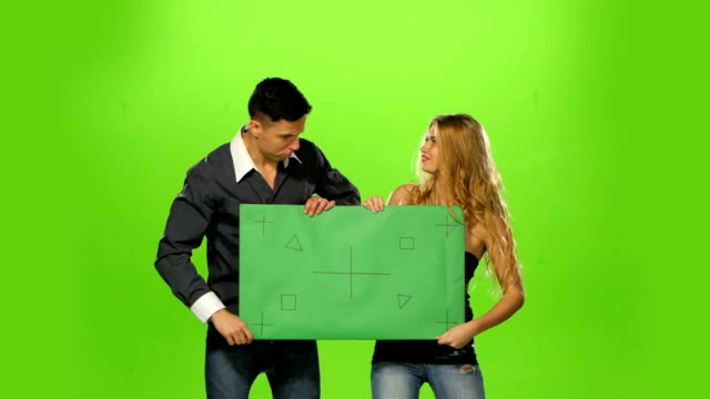 energetic Couple holding up a blank sign, green screen video