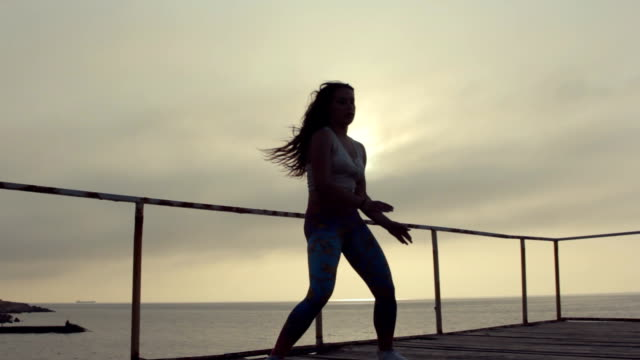 Energetic incendiary dance on the pier near the sea at the sunset video