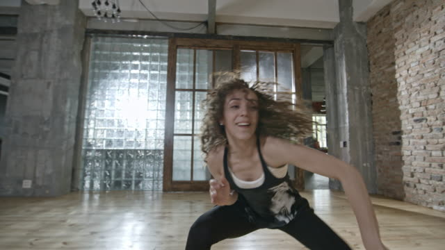 Energetic Woman Dancing in Loft video