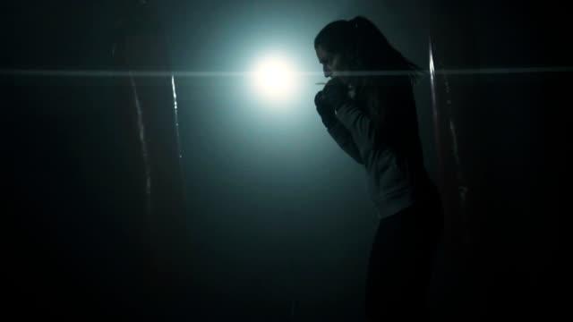 energetic woman shadow boxing - colpire con un pugno video stock e b–roll