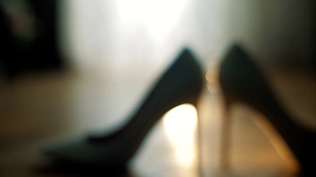 Engagement ring placed in between the brides wedding shoes video