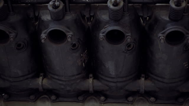 Engine cylinders and valve springs Close-up view of old engine cylinders and valve outer springs crank mechanism stock videos & royalty-free footage