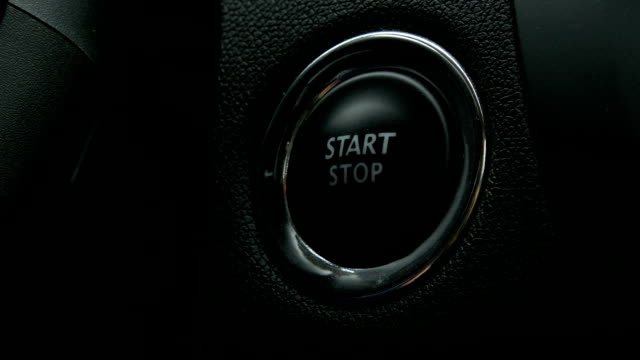 Engine start stop button from a modern car interior video
