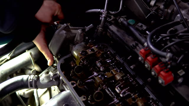 engine valve car maintenance.the cylinder block of the four-cylinder engine. disassembled motor vehicle for repair - cilindro video stock e b–roll