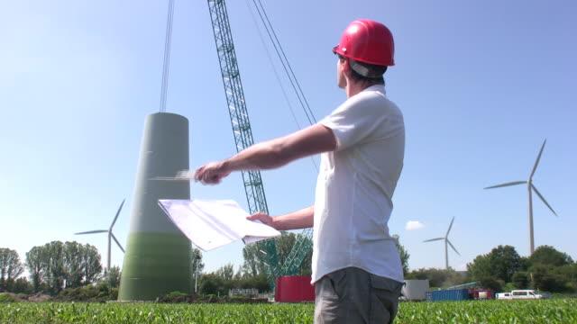 Engineer building wind turbine video
