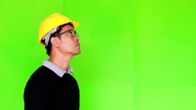Engineer calling on green screen video