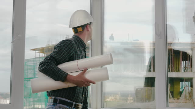Engineer checking construction through the window