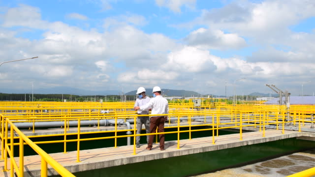 engineer checking water treatment plant - acquedotto video stock e b–roll