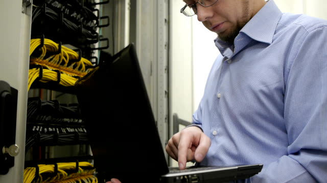IT engineer checks the server rack video