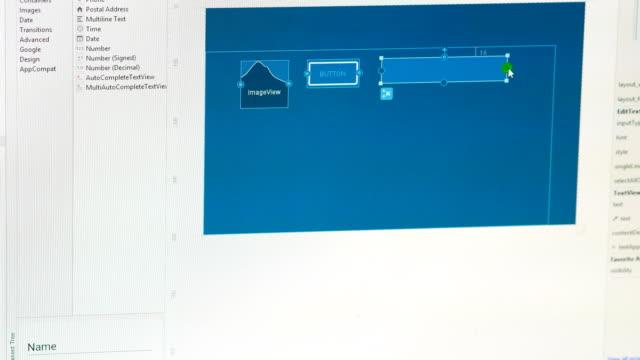 stockvideo's en b-roll-footage met ingenieur ontwerpen van de gebruikersinterface van de software op computer - website