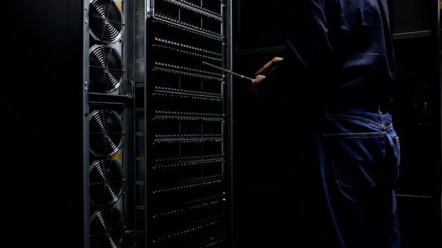 Engineer examining Server room interior