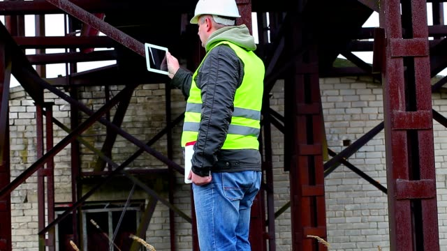 Engineer filmed with tablet PC in factory video