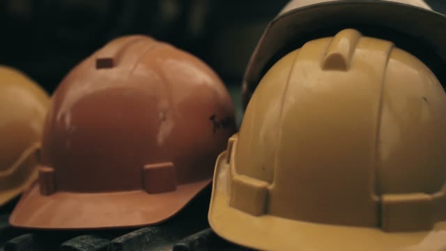 Engineer helmet in construction site. Close up of  Engineer helmet in construction site. work helmet stock videos & royalty-free footage