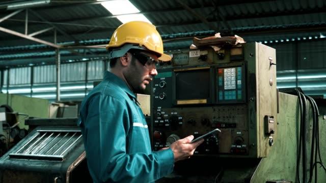 Engineer in Hard Hat Control Machinery Heavy Industry Engineers Using Digital Tablet Computer, Industrial, Machinery, 4K Resolution metal worker stock videos & royalty-free footage