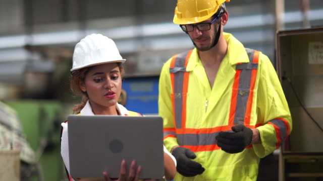 Engineer operation and mentor working on laptop with production line machine Engineer operation and mentor working on laptop with production line machine occupational safety and health stock videos & royalty-free footage