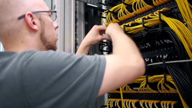 IT engineer paves the yellow ethernet cable video