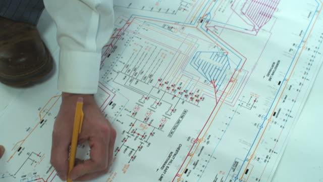 HD CRANE: Engineer reads blueprints video