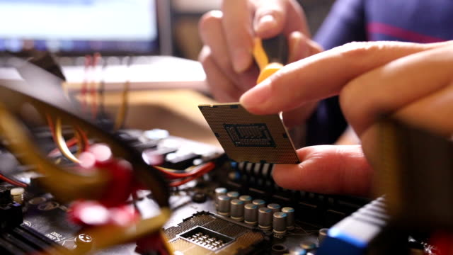 engineer repairing computer motherboard - processore video stock e b–roll