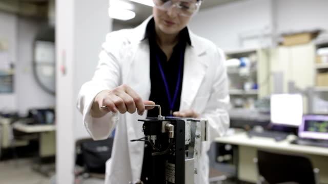 Engineer repairing machine, panning shot video