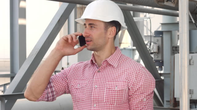 Engineer speaking phone on the industrial background video