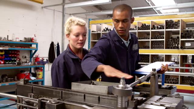 Engineer Teaching Apprentice To Use Tube Bending Machine video