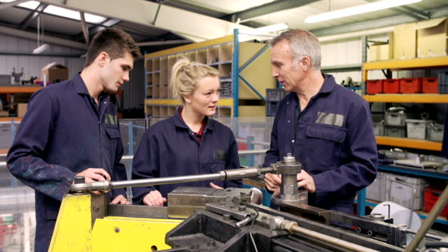 Engineer Teaching Apprentices To Use Tube Bending Machine video