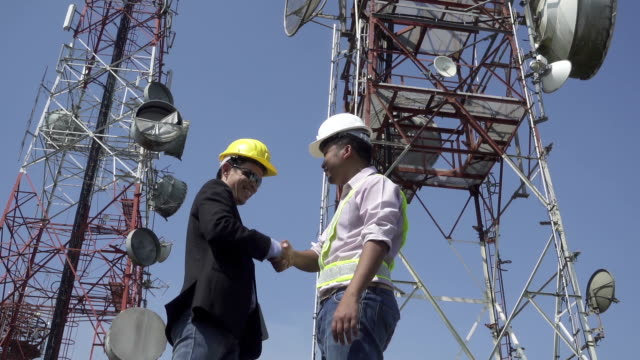 Engineer team at communication tower video