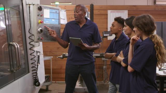 Engineer Training Apprentices On CNC Machine Shot On R3D