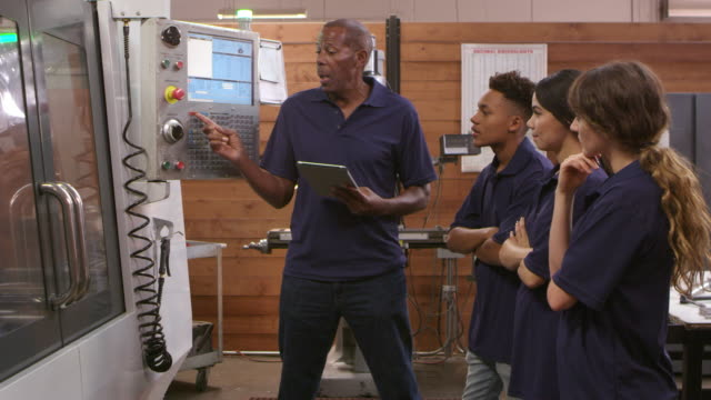Engineer Training Apprentices On CNC Machine Shot On R3D video