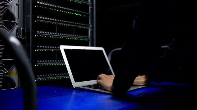 Engineer typing on working table in Server room Engineer typing on working table in Server room mainframe stock videos & royalty-free footage