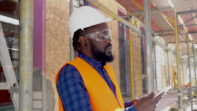 Engineer using tablet at construction site video