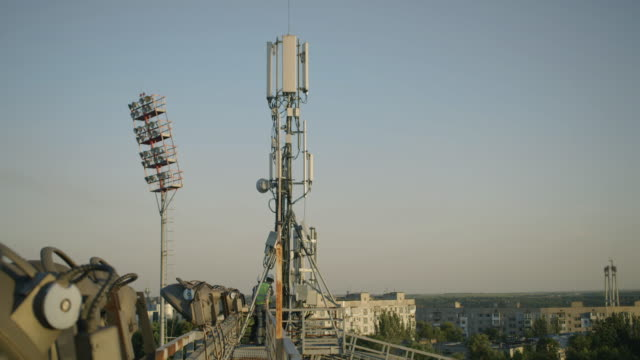 Engineer walking on a cellular tower Tracking shot of an engineer walking on a cellular tower railing stock videos & royalty-free footage