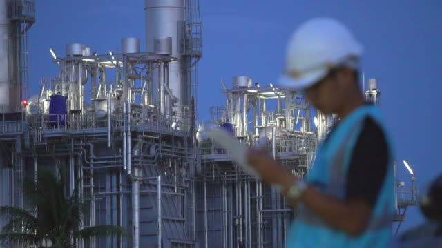 Engineer with tablet at industrial, oil or gas plant video