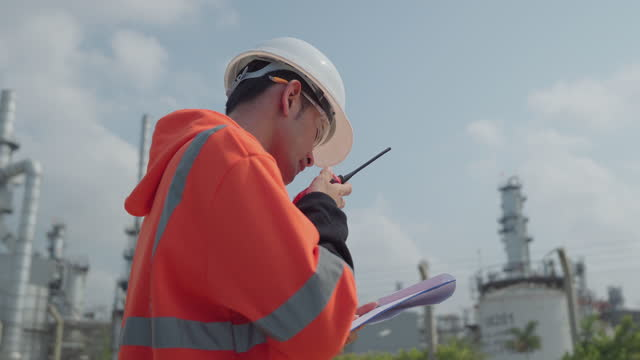 Engineer Worker at industrial plant working oil or gas plant.