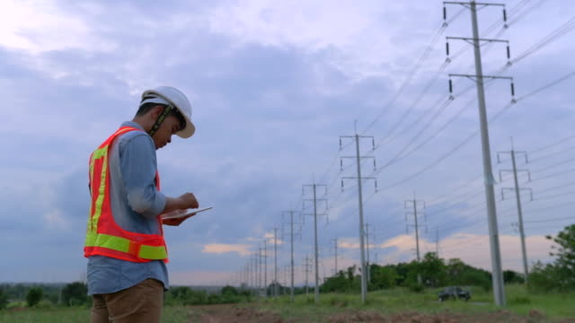 Engineer workers, Evaluation electrical energy, slow motion video