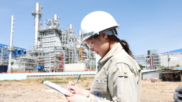 Engineer Working at Power Plant with Clipboard video