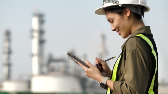 engineer working at power plant with digital tablet - centrale elettrica video stock e b–roll