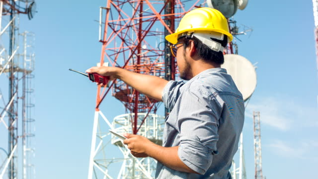 HD DOLLY : Engineer working at telecommunication tower site. video